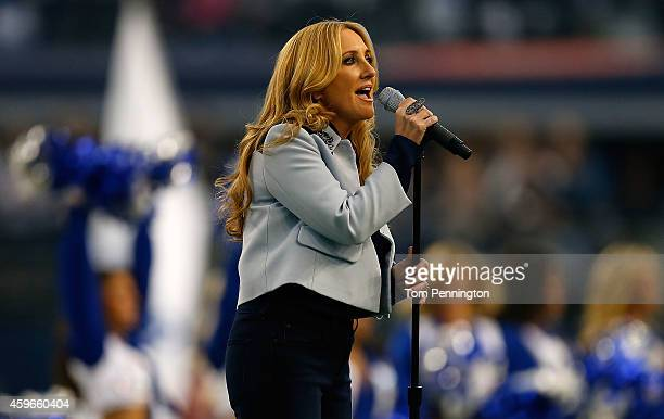 Singer Lee Ann Womack performs the national anthem before the start of the Thanksgiving Day game between the Philadelphia Eagles and the Dallas...