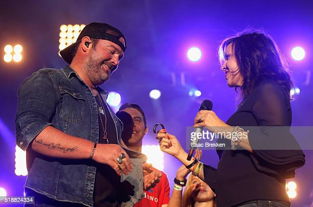 Singer Lee Brice and Ginger Gilbert Ravella speak onstage at the 4th ACM Party for a Cause Festival at the Las Vegas Festival Grounds on April 2 2016...