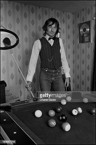 Singer Lee Brilleaux of English rock group Dr Feelgood playing pool at his home on Canvey Island Essex 1979