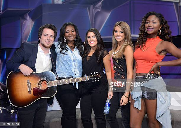 Singer Lee DeWyze and contestants Candice Glover Kree Harrison Angie Miller and Amber Holcomb onstage at FOX's American Idol Season 12 Top 4 to 3...