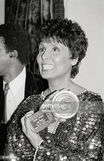 Singer Lena Horne holds the Eubie Award she won from the New York Chapter of the National Academy of Recording Arts and Sciences