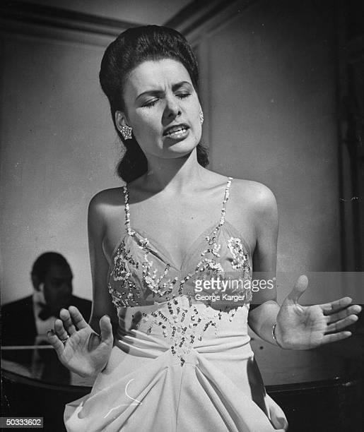 Singer Lena Horne singing Cole Porter's Let's Do It w/o a microphone in front of rapt guests in Savoy-Plaza Hotel's Cafe Lounge.