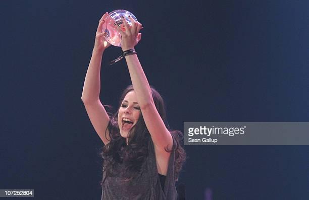 Singer Lena MeyerLandrut celebrates after winning the Best Single Award at the '1Live Krone' Music Awards on December 2 2010 in Bochum Germany