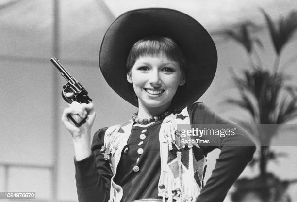 Singer Lena Zavaroni pictured wearing a cowgirl costume, March 31st 1979.