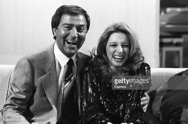 Singer Lena Zavaroni with host Des O'Connor on set of the 'Des O'Connor Show' filmed at Thames Studios in London, England on October 14, 1984.