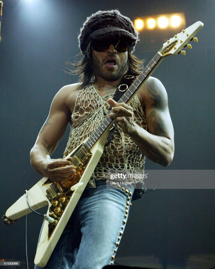 Singer Lenny Kravitz performs on stage at the only UK date on his European tour on July 7, 2004 at Wembley Arena in London, England.