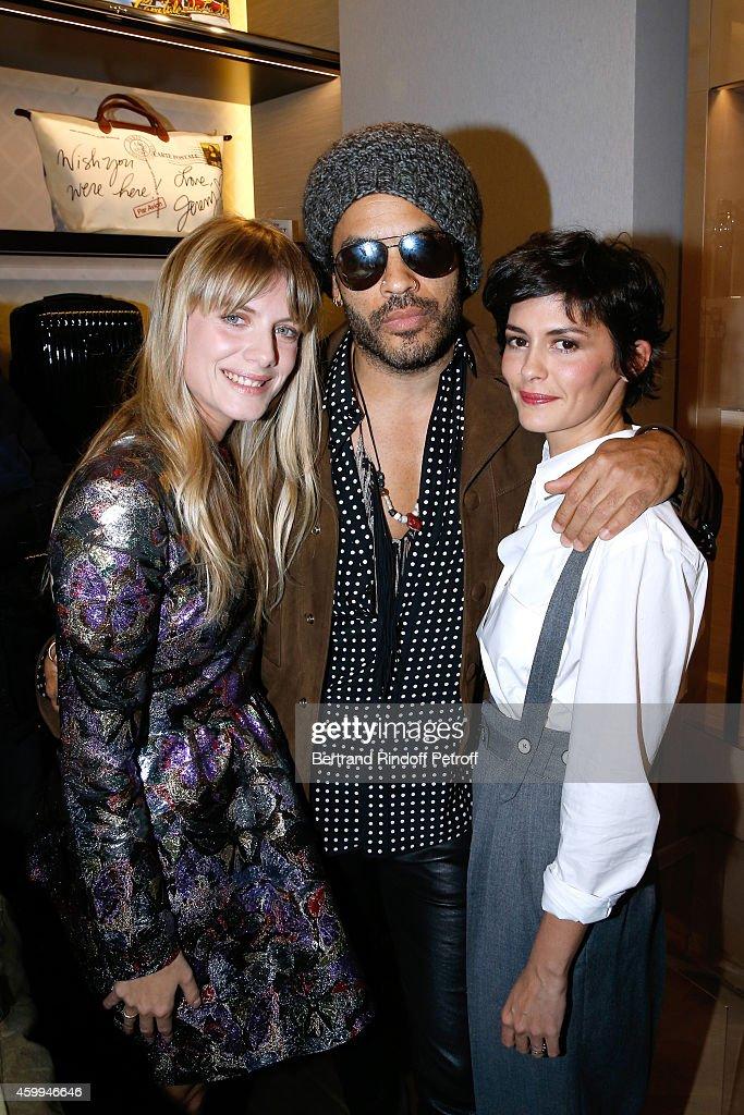 Singer Lenny Kravitz standing between actresses Melanie Laurent (L) Audrey Tautou (R) attend the Longchamp Elysees 'Lights On Party' Boutique Launch on December 4, 2014 in Paris, France.
