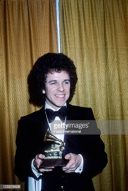 Singer Leo Sayer holds the Grammy he won for 'Best Rhythm And Blues Song' for his song 'You Make Me Feel Like Dancing' at the 20th Annual Grammy...