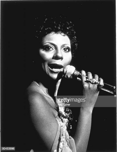 Singer Leslie Uggams holding a mike as she performs on stage in the musical revue Jerry's Girls.