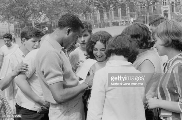 Singer Levi Stubbs of American vocal group the Four Tops signing autographs at a sports event in New York City 1965