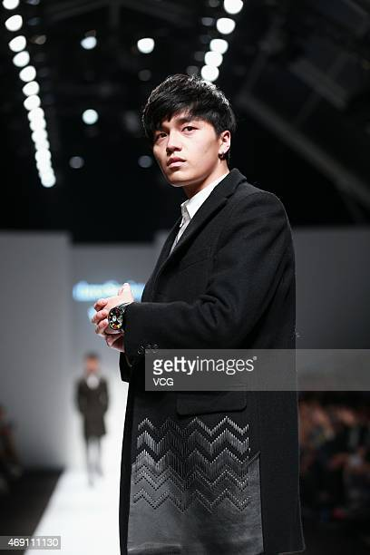 Singer Li Xiangxiang walks the runway during the threeSociety show as part of Shanghai Fashion Week Autumn/Winter Collection on April 9, 2015 in...