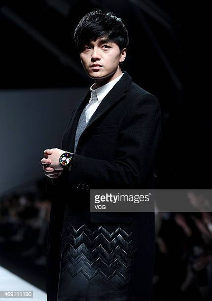 Singer Li Xiangxiang, watch detail, walks the runway during the threeSociety show as part of Shanghai Fashion Week Autumn/Winter Collection on April...