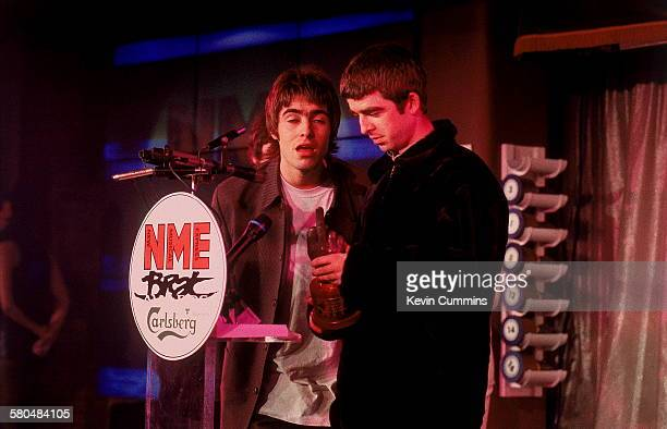 Singer Liam Gallagher and his guitarist brother Noel Gallagher of Manchester rock band Oasis at the NME Brat Awards held in London 1995 Oasis won the...