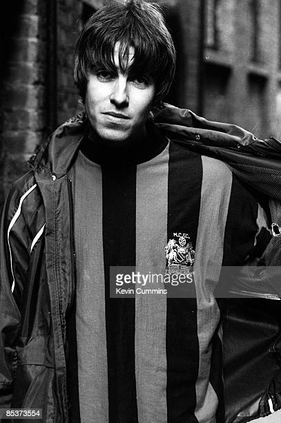 Singer Liam Gallagher of British rock group Oasis in a Manchester City shirt London 17th March 1994