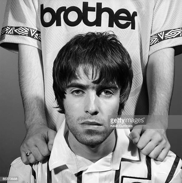 Singer Liam Gallagher of British rock group Oasis in a Manchester City shirt Portsmouth 9th May 1994 Standing behind him is his brother Noel