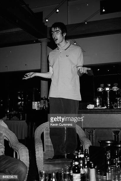 Singer Liam Gallagher of Manchester rock group Oasis, standing on a chair in a bar in Portsmouth during the group's 'Definitely Maybe' tour, 2nd May...