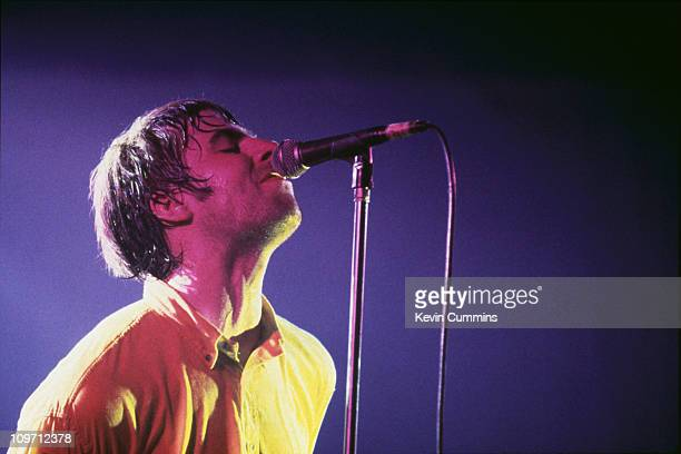 Singer Liam Gallagher performing with British pop group Oasis at the Glastonbury Festival 1995