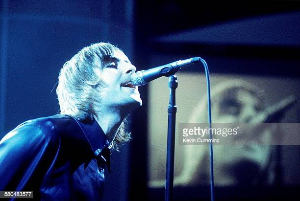 Singer Liam Gallagher performing with British rock band Oasis circa 2000