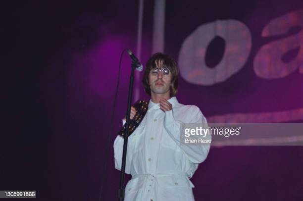 Singer Liam Gallagher performing with British rock group, Oasis, at Knebworth House, Hertfordshire, 10th August 1996.