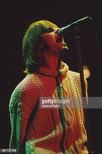 Singer Liam Gallagher performing with Oasis on one of two nights at Knebworth House, Hertfordshire, 10th-11th August 1996.
