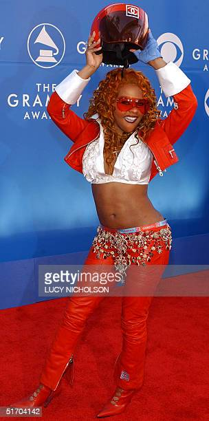 US singer Lil' Kim arrives at the 44th Annual Grammy Awards in Los Angeles CA 27 February 2002 AFP PHOTO/Lucy NICHOLSON