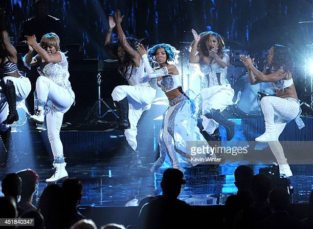 Singer Lil Mama performs with singers Tionne TBoz Watkins and Rozonda Chilli Thomas of TLC onstage during the 2013 American Music Awards at Nokia...