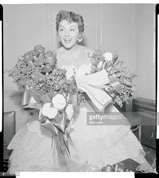 Singer Lillian Roth is surrounded by flowers and telegrams after her opening at the Macomb She was given a loud and long applause by the packed house...