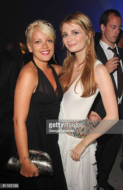 Singer Lily Allen and actress Mischa Barton attend the AKVINTA GQ Party for How to Lose Friends Alienate People Premiere at the Festival House Villa...