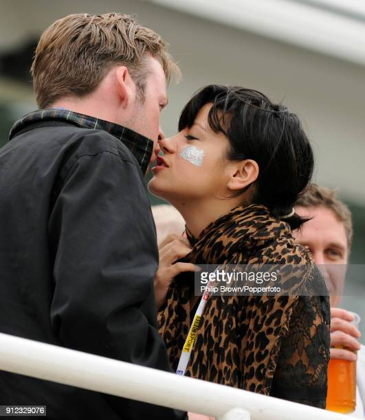 Singer Lily Allen kisses her partner Sam Cooper in the Bedser Stand during the lunch interval on day one of the 5th Test match between England and...