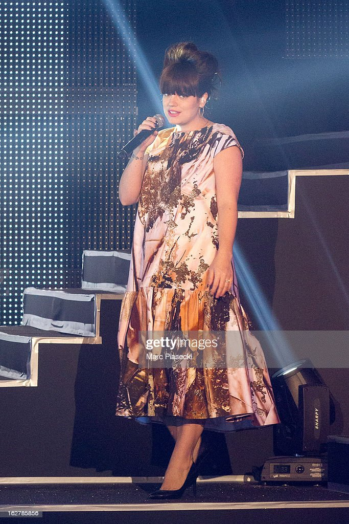 Singer Lily Allen performs during the 'Etam Live Show Lingerie' at Bourse du Commerce on February 26, 2013 in Paris, France.