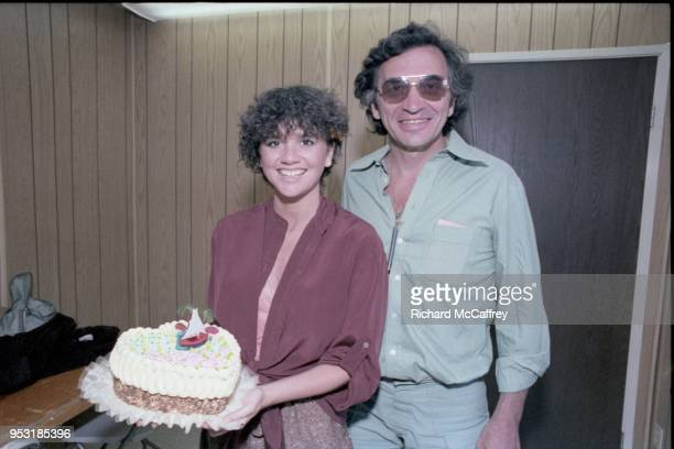Singer Linda Ronstadt and promoter Bill Graham backstage at Day on the Green concert at Oakland Coliseum on May 28 1978 in Oakland California
