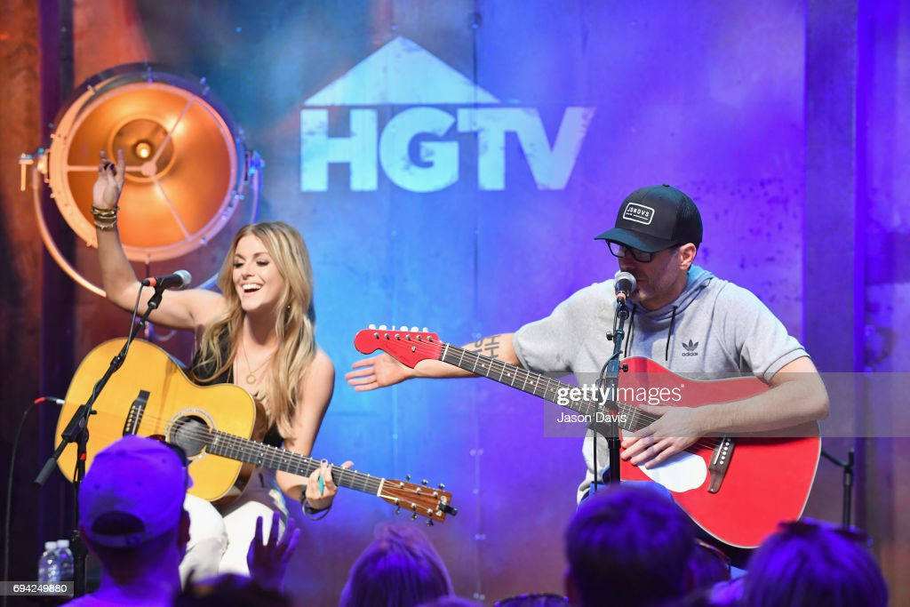 Singer Lindsay Ell and radio personality Bobby Bones perform onstage at the HGTV Lodge during CMA Music Fest on June 9, 2017 in Nashville, Tennessee.