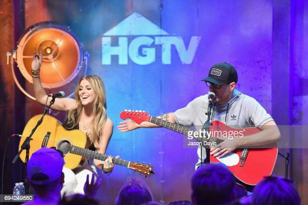 Singer Lindsay Ell and radio personality Bobby Bones perform onstage at the HGTV Lodge during CMA Music Fest on June 9 2017 in Nashville Tennessee