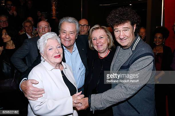 Singer Line Renaud actor Alain Delon Miss Francois Pinault Maryvonne and Robert Charlebois pose after the Robert Charlebois '50 ans 50 chansons'...