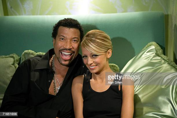Singer Lionel Richie and his daughter actress Nicole Richie appear on the set of his ''I Call It Love'' video shoot on July 23 2006 in Hollywood...