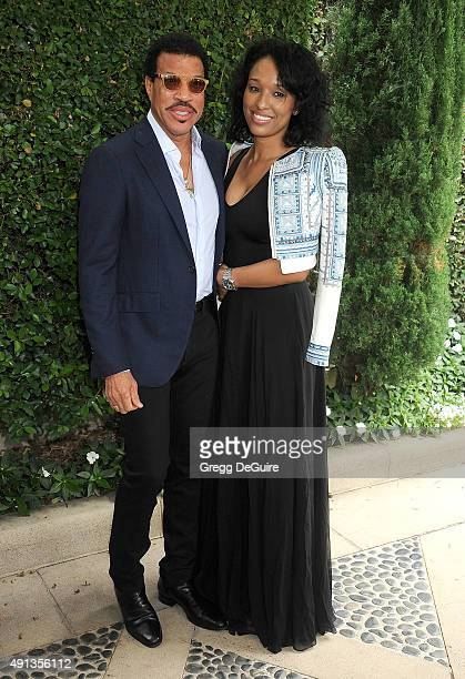 Singer Lionel Richie and Lisa Parigi arrive at The Rape Foundation's Annual Brunch at Greenacres The Private Estate of Ron Burkle on October 4 2015...