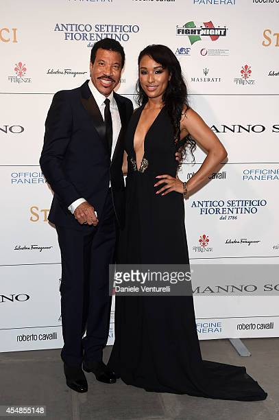Singer Lionel Richie and Lisa Parigi attend 'Celebrity Fight Night In Italy' Gala at the Palazzo Vecchio on September 7 2014 in Florence Italy