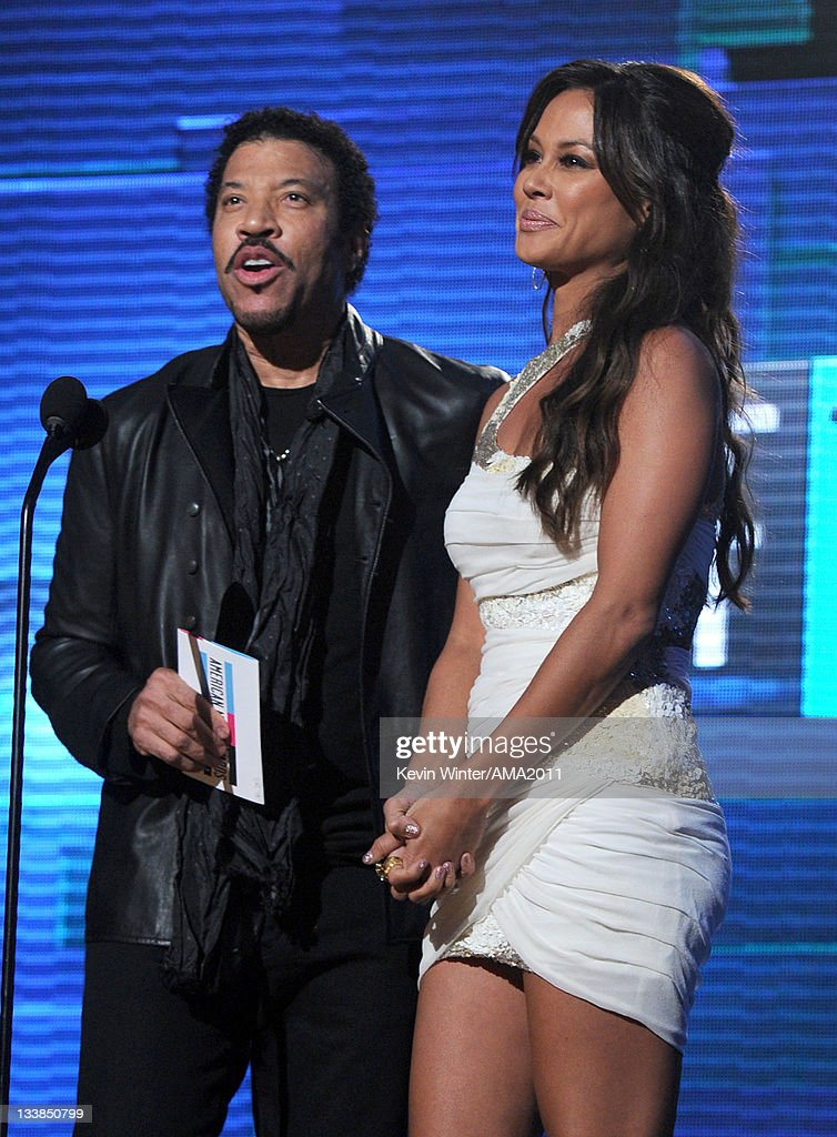 Singer Lionel Richie and tv personality Vanessa Lachey speak onstage at the 2011 American Music Awards held at Nokia Theatre L.A. LIVE on November 20, 2011 in Los Angeles, California.