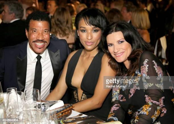Singer Lionel Richie Lisa Parigi and Laura Pausini attend the Celebrity Fight Night gala celebrating Celebrity Fight Night In Italy benefitting The...