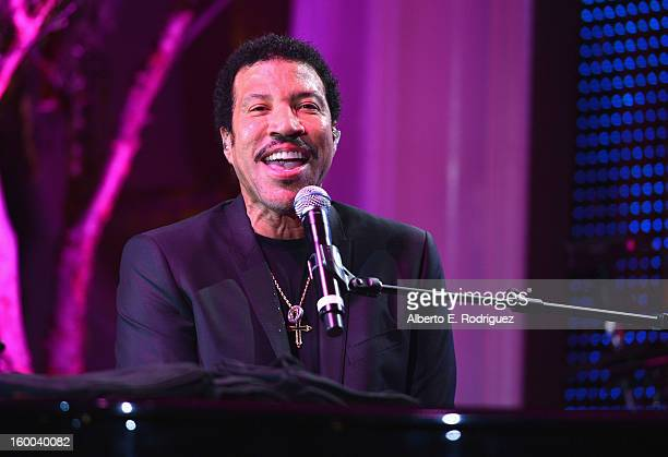"""Singer Lionel Richie performs at The Voice Health Institute's """"Raise Your Voice"""" benefit at the Beverly Hills Hotel on January 24, 2013 in Beverly..."""