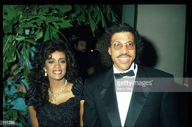Singer Lionel Ritchie and wife pose at the 7th Annual American Cinema Awards January 27, 1990 at the Beverly Hilton Hotel in Los Angeles, CA. Billed...
