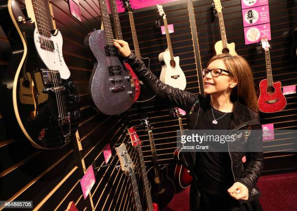 Singer Lisa Loeb attends the 2014 National Association of Music Merchants show at the Anaheim Convention Center on January 24 2014 in Anaheim...