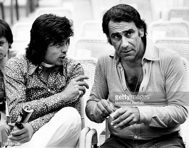 Singer Little Tony born Antonio Ciacci is seated chatting with Alberto Lupo an Italian actor they are on the terraces waiting for the broadcasting of...