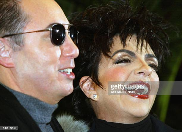 US singer Liza Minnelli and producer David Gest pose 24 January 2002 during a press conference in London Minnelli starts a European tour produced by...