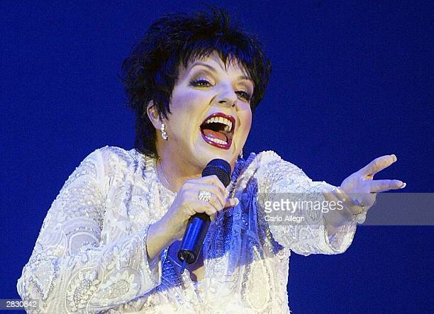 Singer Liza Minnelli performs at the Macy's and American Express Passport 2003 to raise money for HIV research on October 2 2003 in Santa Monica...