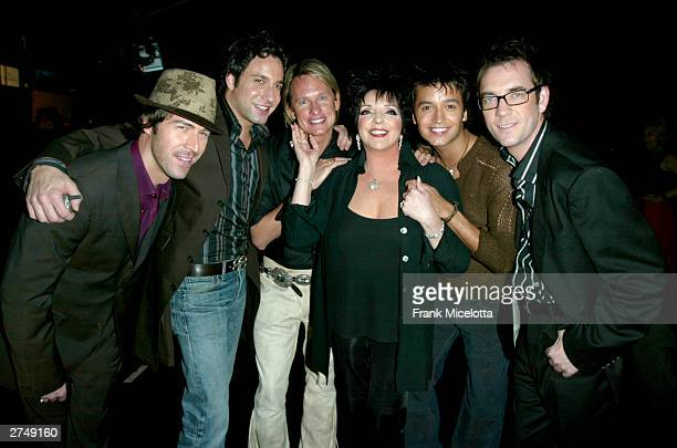 """Singer Liza Minnelli poses backstage with members of """"Queer Eye for the Straight Guy"""" at VH1's Big In 2003 Awards on November 20, 2003 at Universal..."""