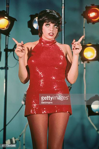 Singer Liza Minnelli wearing sequined minidress