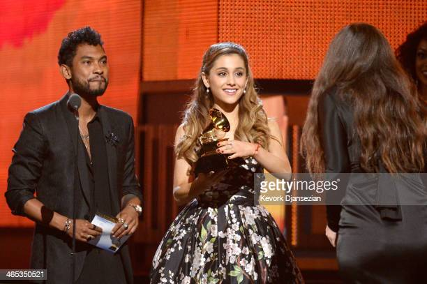Singer Lorde accepts the Best Pop Solo Performance award for 'Royals' from singers Miguel and Ariana Grande onstage during the 56th GRAMMY Awards at...