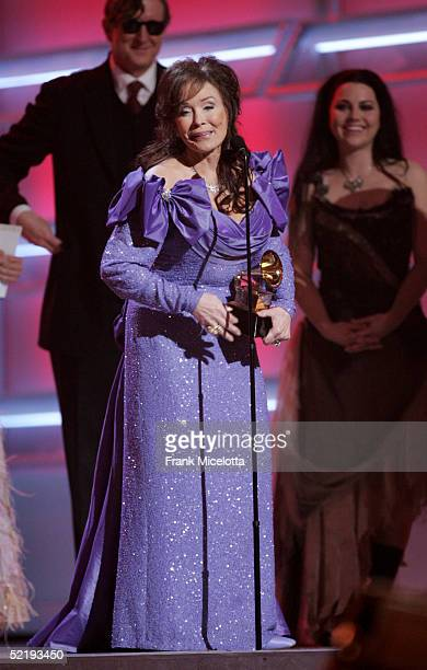 Singer Loretta Lynn accepts the award for Best Country Album for 'Van Lear Rose' on stage during the 47th Annual Grammy Awards at the Staples Center...