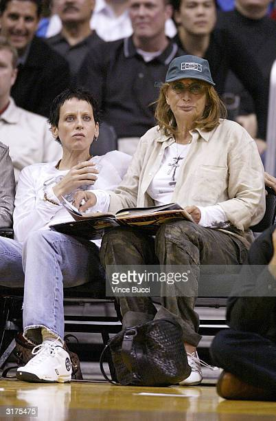Singer Lori Petty and actress/director Penny Marshall attend the game between the Los Angeles Lakers and the New Orleans Hornets on March 30 2004 in...